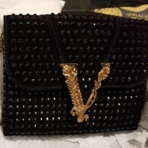 Versace studded clutch, new this season
